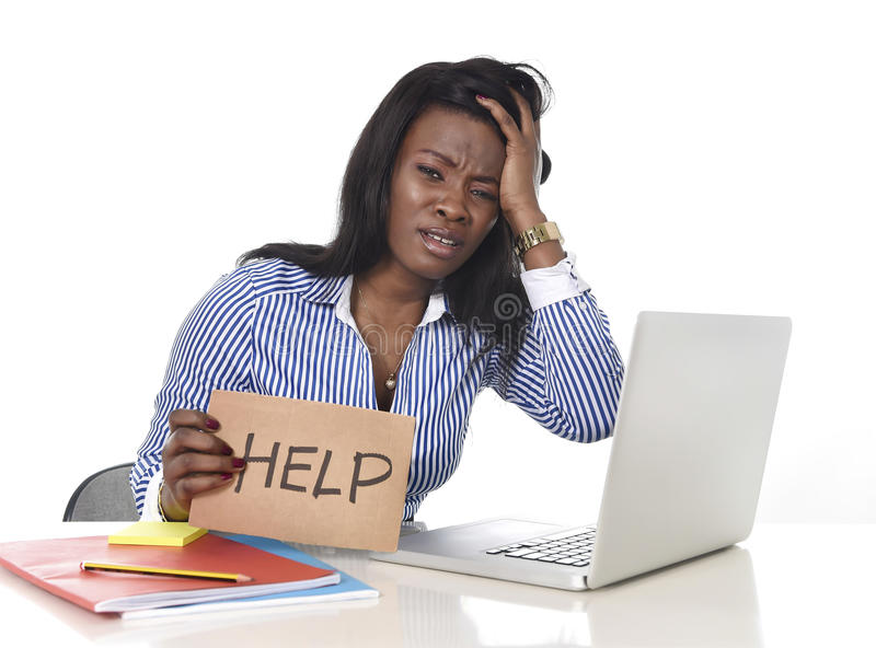 Black African American ethnicity frustrated woman working in stress at office royalty free stock photography