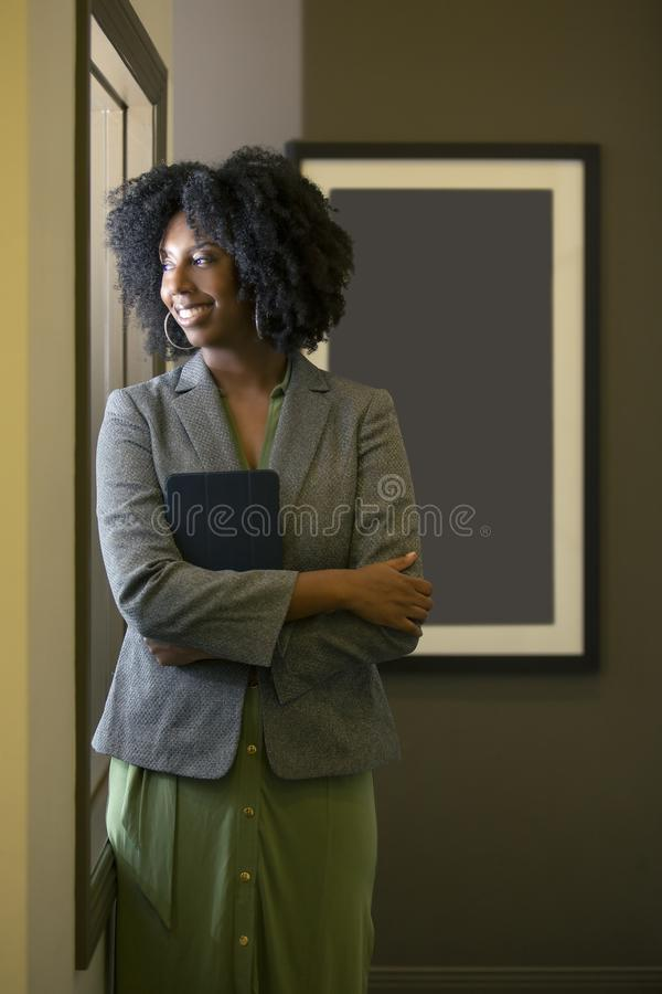 Black African American Female Businesswoman with a Tablet royalty free stock image