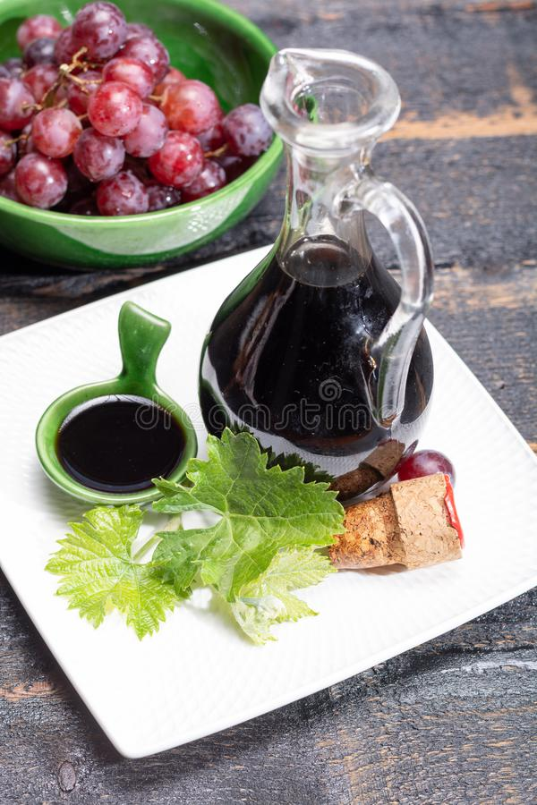 Black aged natural balsamic vinegar dressing from Modena, Italy. Black aged natural dark balsamic vinegar dressing from Modena, Italy royalty free stock photography