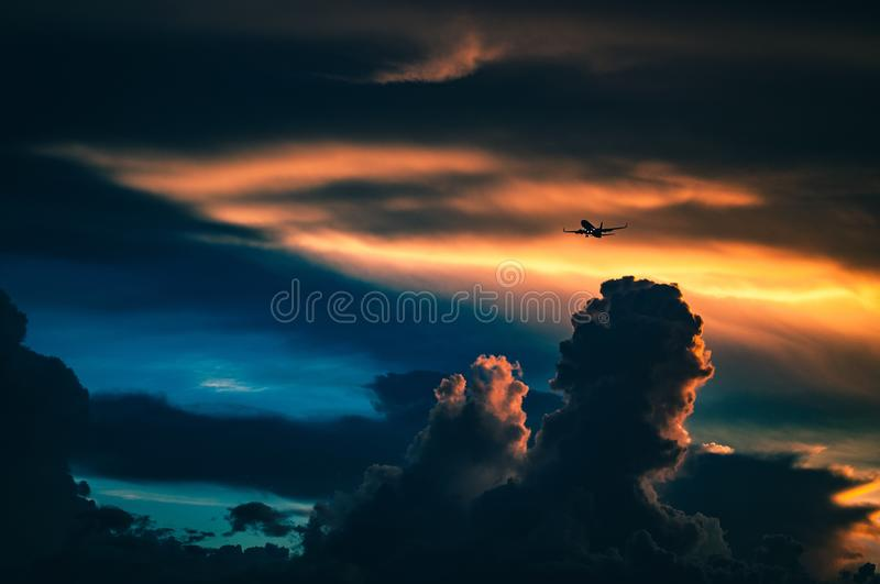 Black Airplane Flying On The Orange And Lbue Sky Free Public Domain Cc0 Image