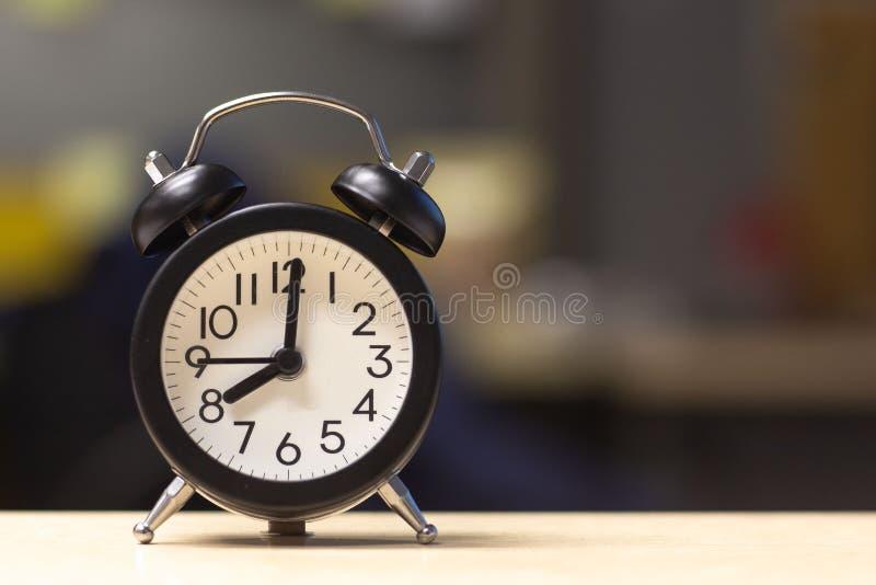 Black Alarm Clock on desk royalty free stock image