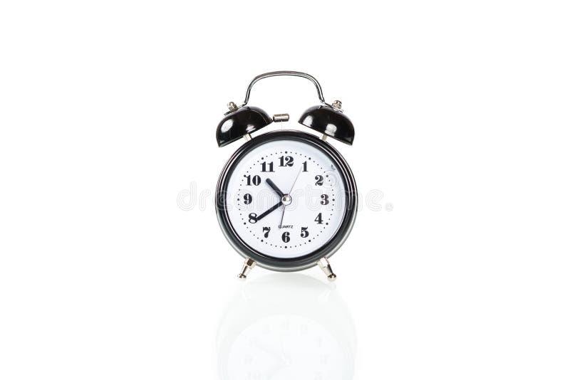 Black alarm clock. Isolated on white background stock images