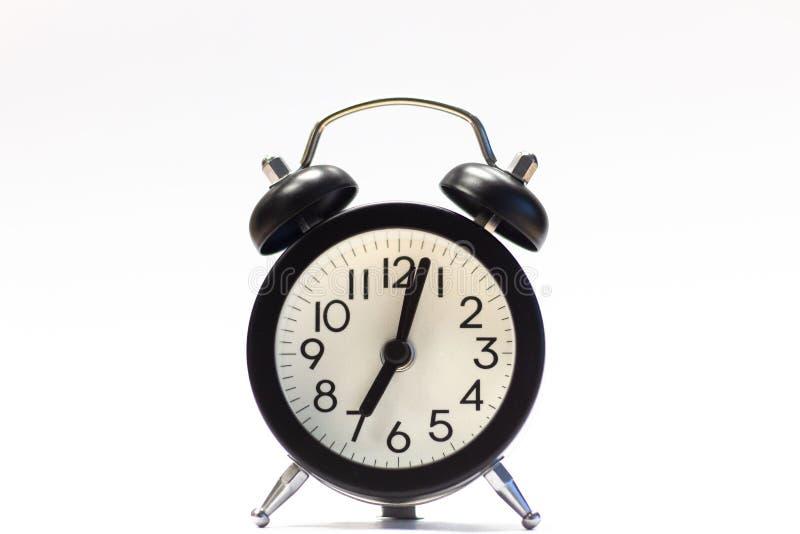 Black Alarm Clock isolated on white royalty free stock photos