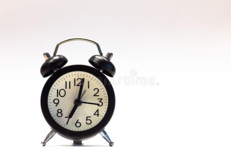 Black Alarm Clock isolated on white royalty free stock images