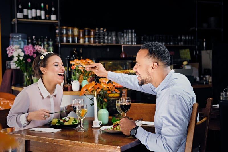 Black American male and female eating vegan food. royalty free stock image