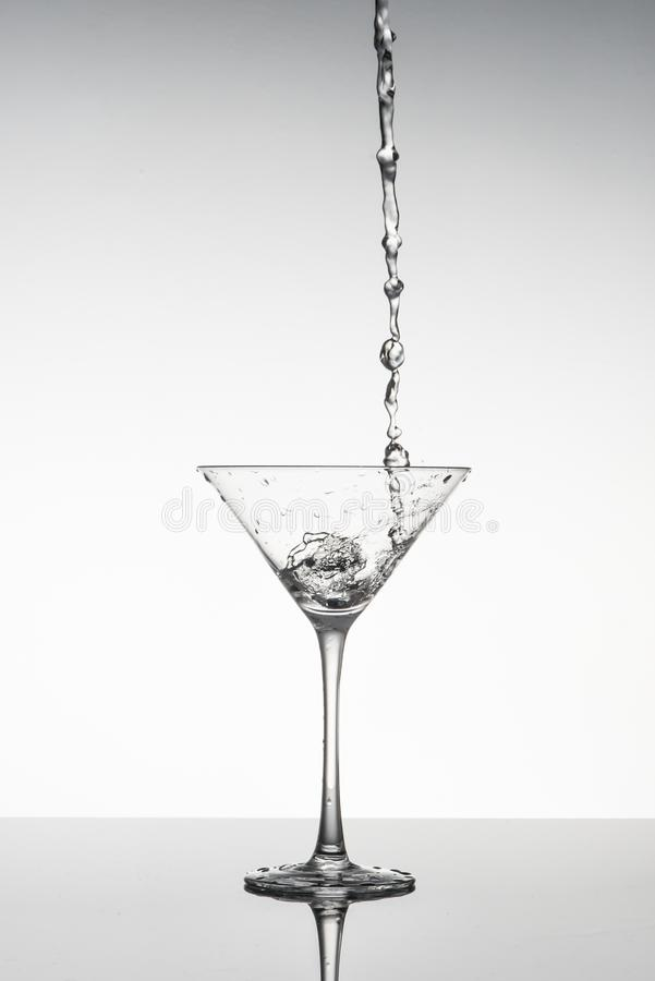 Free Black And White Image Of A Martini Glass With Liquid Pouring Into It Royalty Free Stock Images - 120179359