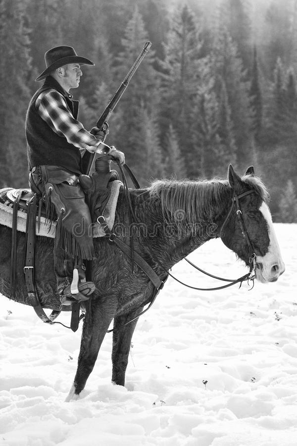 Free Black And White Photograph Of Ranch Hand With Repeating Rifle Stock Photos - 49564373