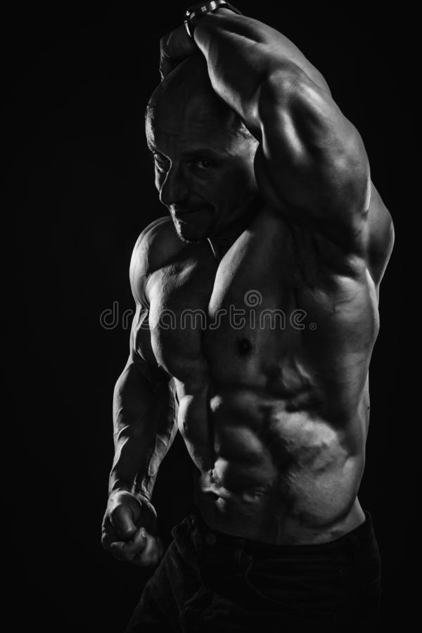 Free Black And White Portrait Of Bald Shirtless Male Bodybuilder With Perfect Six Pack Prompting To Sport And Training Stock Images - 166187514