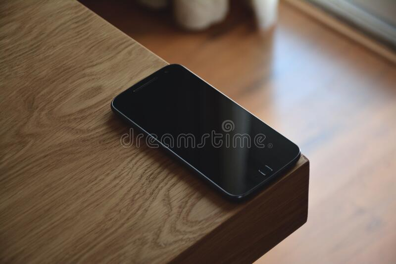 Black Android Smartphone on Corner Table stock photography
