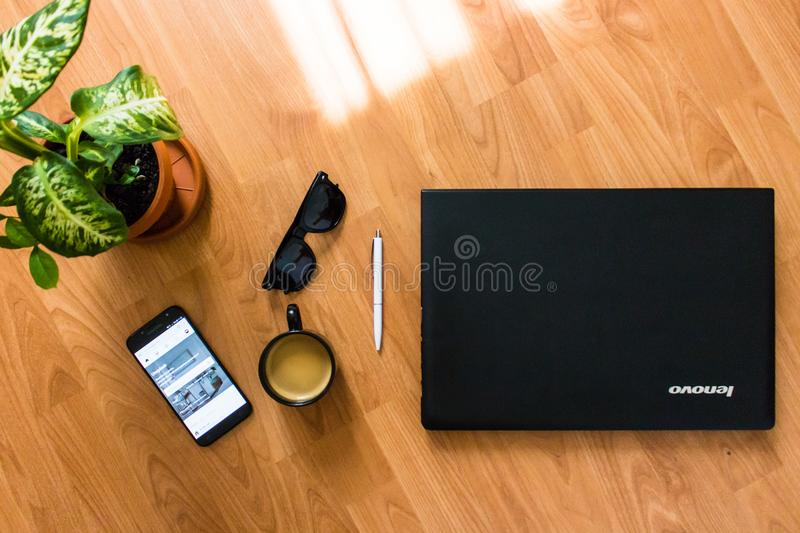 Black Android Smartphone Near Black Coffee Cup royalty free stock photos