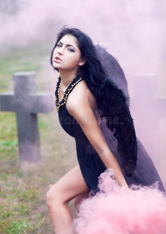 Black angel of war. In the mist stock photos