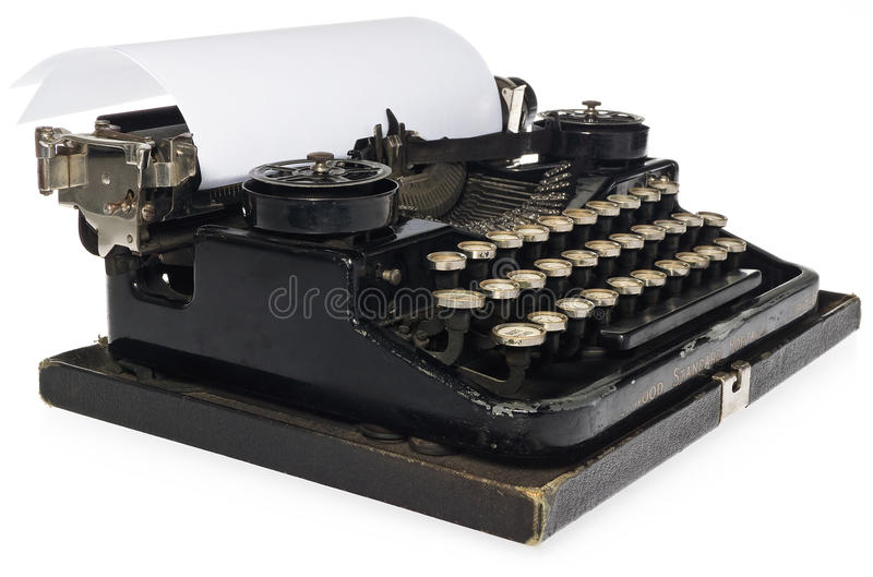 Black antique typewriter, with white blank sheet of paper. stock images
