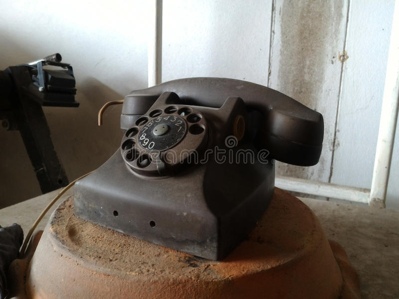 Black antique vintage analog telephone. Dialing or scrolling phone on wooden table,Contact us concept stock photos