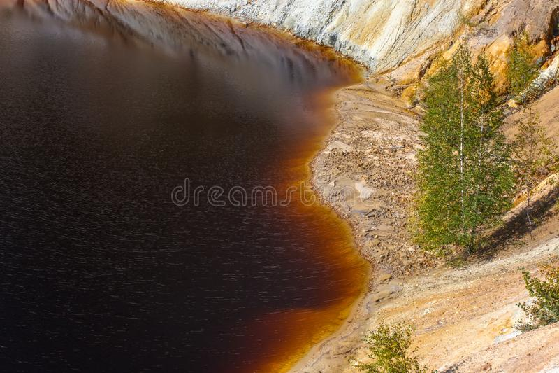 Black artificial lake and hills - mining and production of copper in Bor, Serbia. Black artificial lake and hills as a result of mining and production of copper stock photo