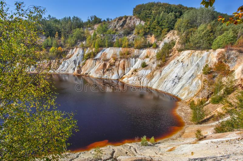 Black artificial lake and hills - mining and production of copper in Bor, Serbia. Black artificial lake and hills as a result of mining and production of copper royalty free stock photography