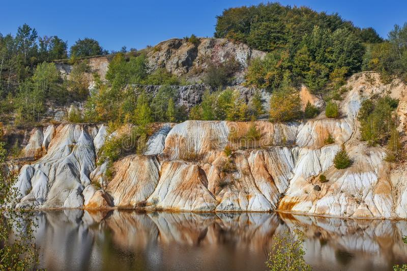 Black artificial lake and hills - mining and production of copper in Bor, Serbia. Black artificial lake and hills as a result of mining and production of copper stock photography