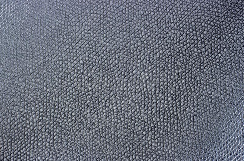 Black artificial leather close-up, texture, background stock image