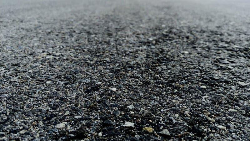 Black Asphalt Trailing Into `Infinity`. An abstract wallpaper of black asphalt trailing off into infinity stock photos