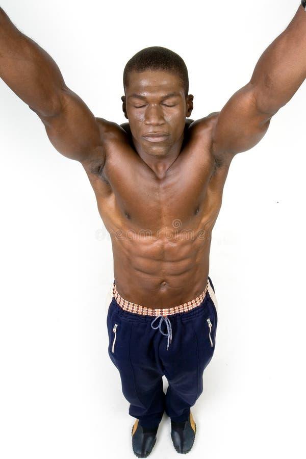 Black athelete raising arms stock images