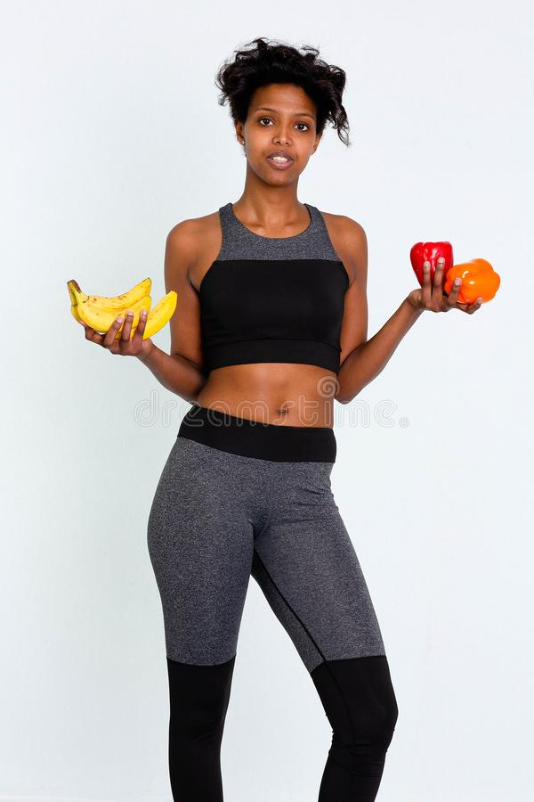 BLack attractive fitness woman, trained female body, Beautiful Sportive Woman Leggins Stock Images. Portrait of a blackwoman. Attractive fitness woman, trained stock photography