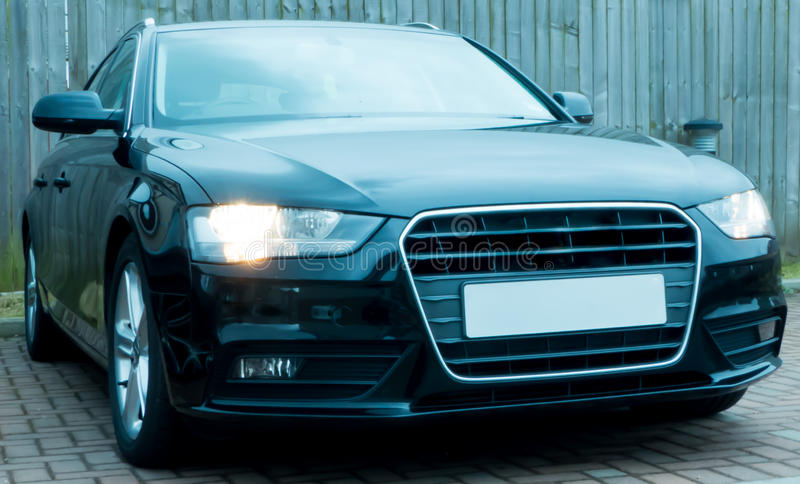 Black Audi A4. With the lights on royalty free stock images