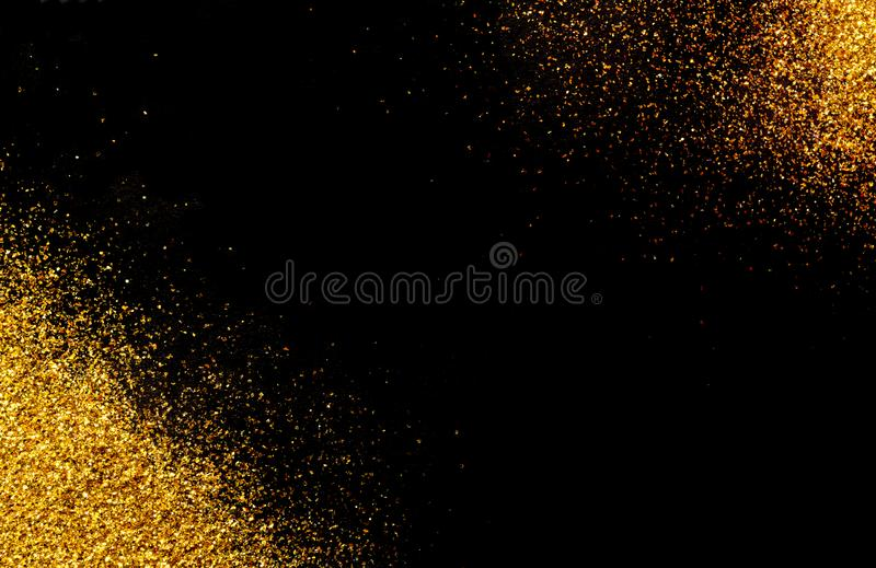 Black background with gold glitter in the corners. stock photos