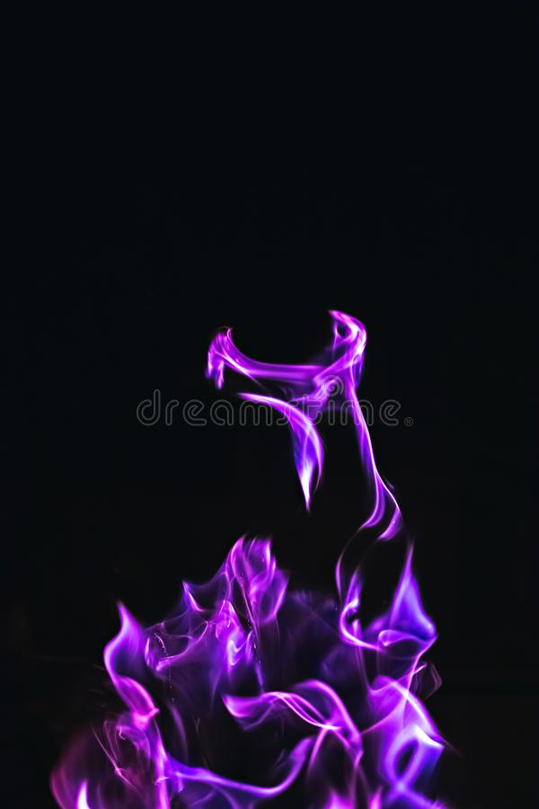Black background image of purple fire forms stock photos