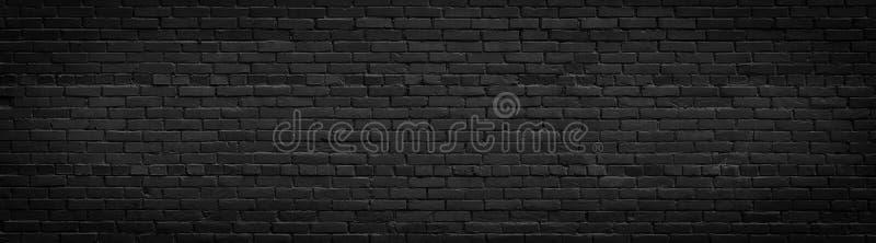 Old black brick wall panorama royalty free stock image
