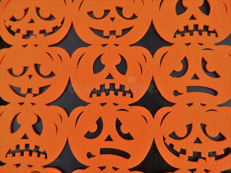 Black background with orange pumpkin heads. Black background with orange pumpkins Heads for Halloween smiling and scary stock photo