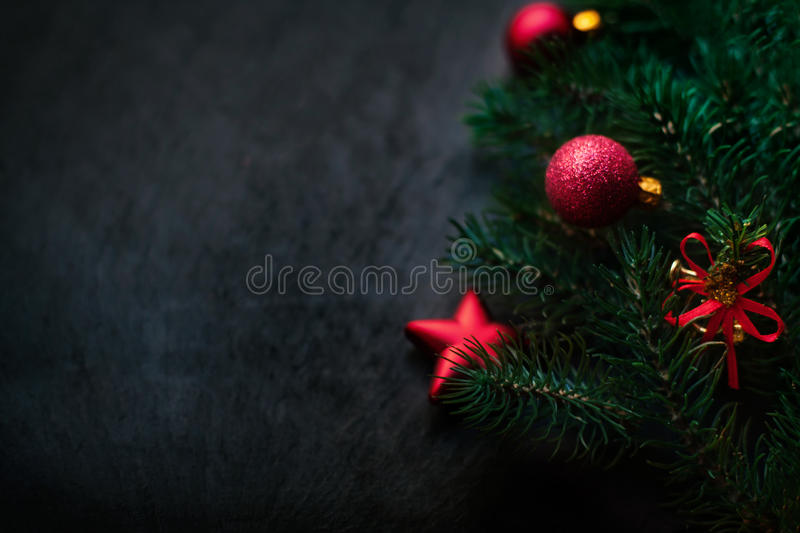 Black background with pine and Christmas toys. New Year Card w stock images