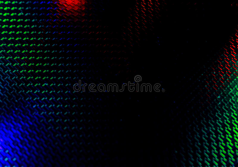 Black background with red and green backlight. Black background with red and green blue backlight irregularities stock photo