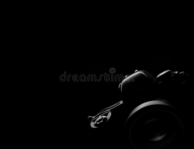 Black background slr camera contour. Professional SLR camera outline contour black background stock photo