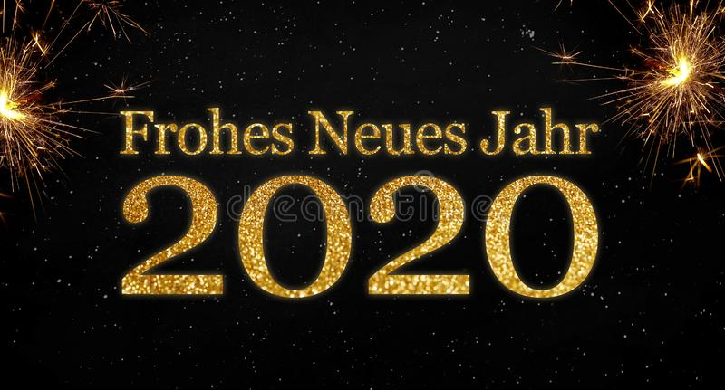 Black background with sparklers and glittery letters showing the german words for happy new year 2020 stock photo