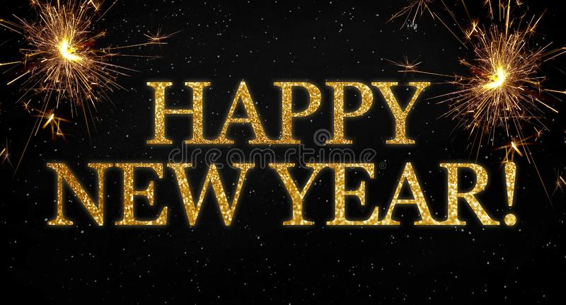 Black background with sparklers and glittery letters showing the words happy new year royalty free stock photos