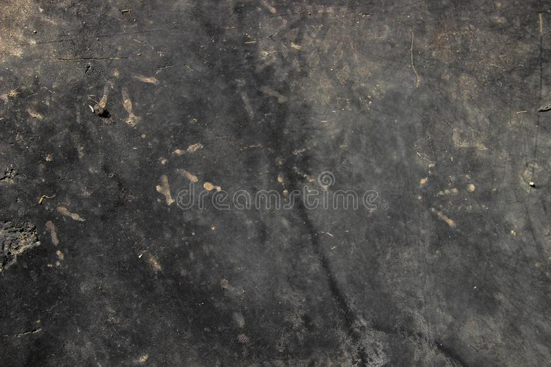 Black background with traces of chicken paws royalty free stock images