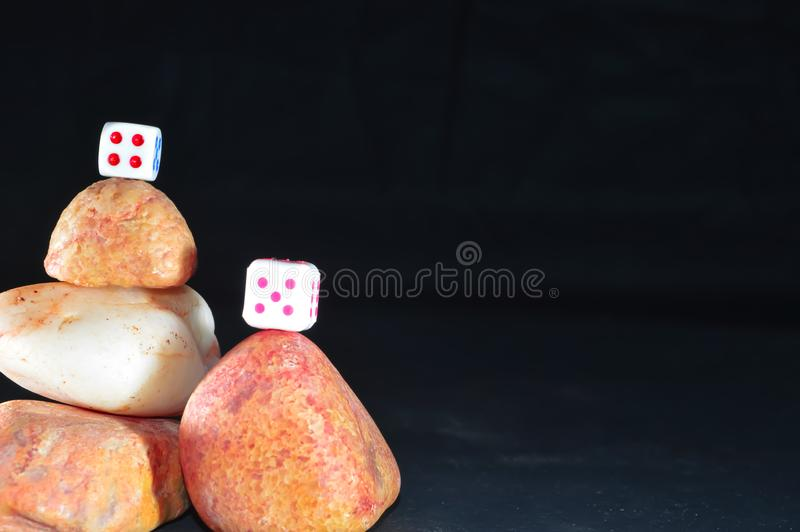 black backgrouund and stone Cairns,dice stock images