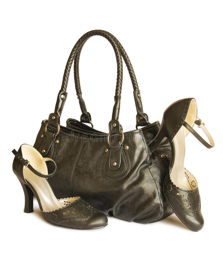 Black Bag With Shoes Isolated On White Royalty Free Stock Photography