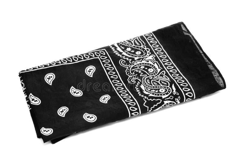 Black bandana handkerchief. Paisley patterned black black bandana handkerchief on a white white background royalty free stock photo