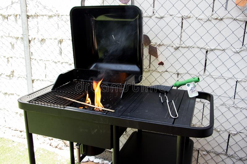 Black barbecue in the backyard stock photo