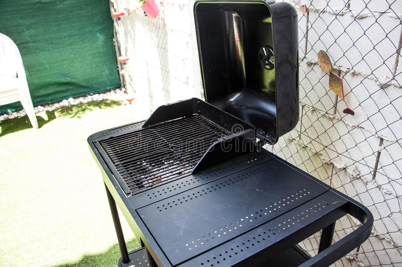 Black barbecue in the backyard of a house stock photos