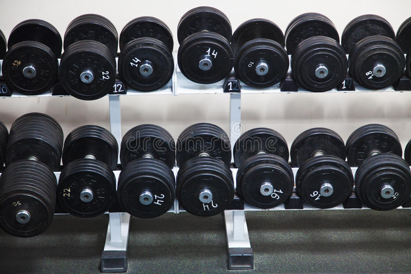 Black Barbells at the gym royalty free stock photo