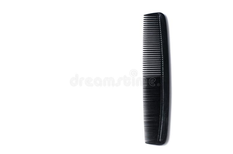 Black barber comb isolated on white background. Barber accessories, copy space. Style, hair, care, hairdresser, fashion, beauty, tool, hairbrush, equipment royalty free stock photo