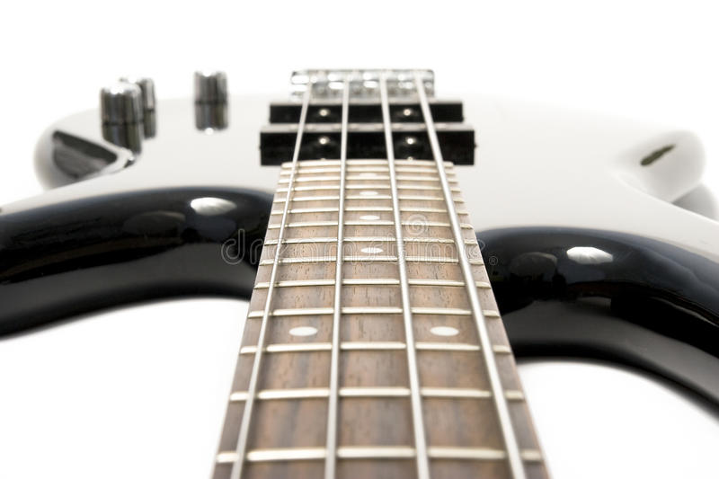 Black bass guitar with strained strings stock photo