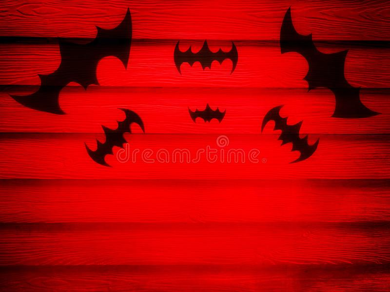 Black bats on red wall stock photos