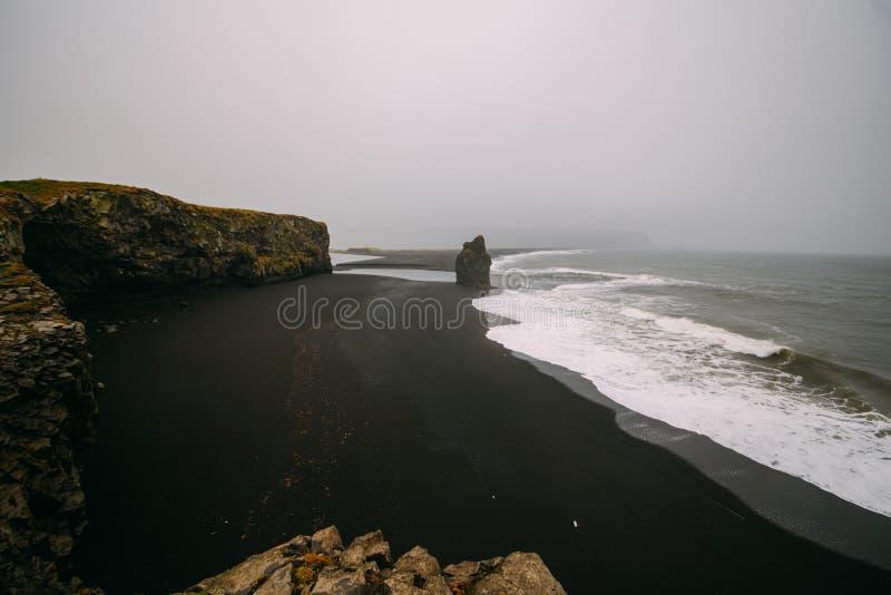 Black beach Kirkjufjara during the storm on Atlantic ocean. Black sandy beach on Atlantic coast royalty free stock image