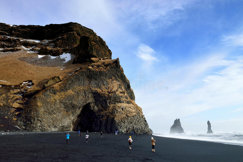 Black Beach, Vik, Iceland. One of the most beautiful beaches on Earth. Its stretch of black basalt sand is one of the wettest places in Iceland. The cliffs west royalty free stock image