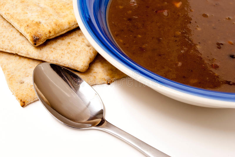 Black Bean Soup with Pita Bread, with spoon. stock photography