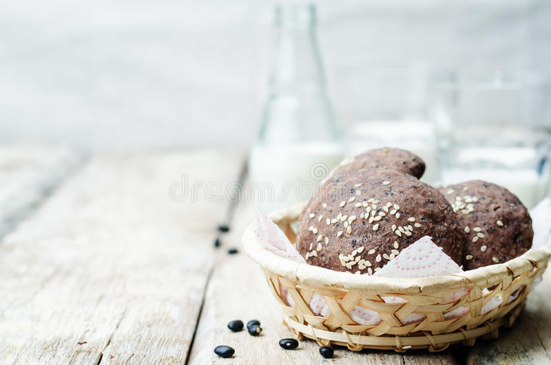 Black beans buns with sesame seeds. On a white background. toning. selective Focus stock photo