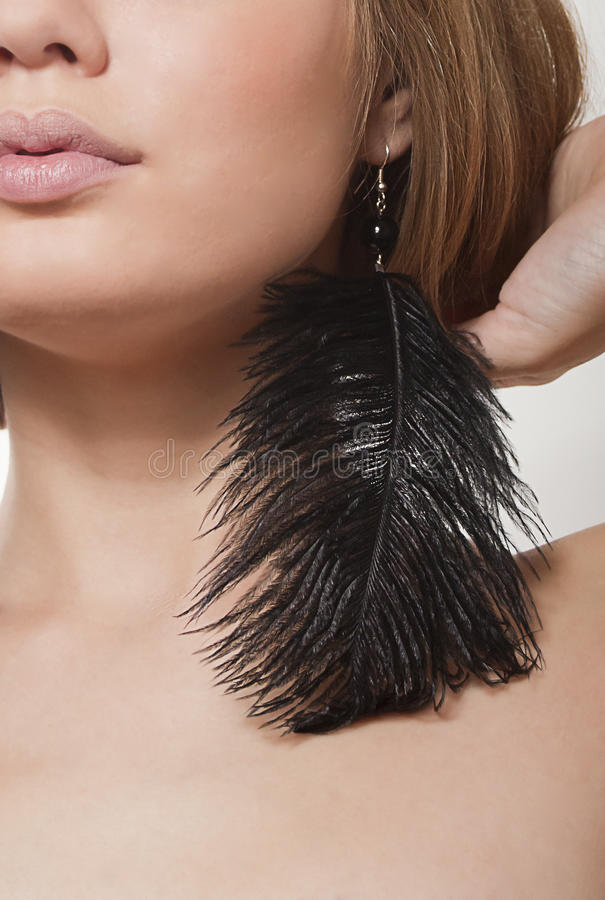 Black Beautiful Earrings-feathers Stock Photo