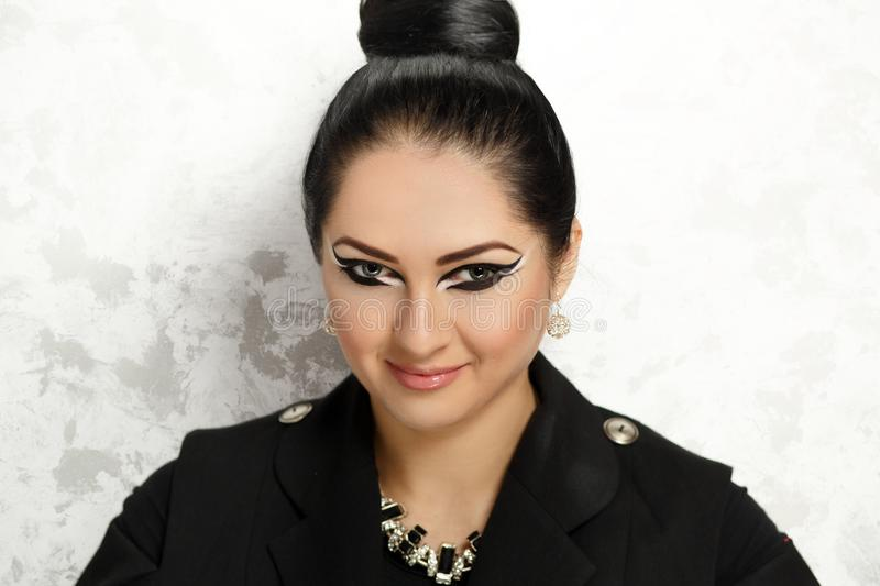 Black Beauty make up. Young beautiful woman, professional make up, hair styling. Woman is ready for the party or the great event. dangerous ninja warrior, black stock image